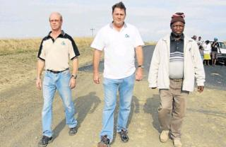END OF ROAD: Concerned community members Gerald Goosen, Sherwin Carr and Lucky Sitwayi walk on an abandoned tar road project on the Wild Coast