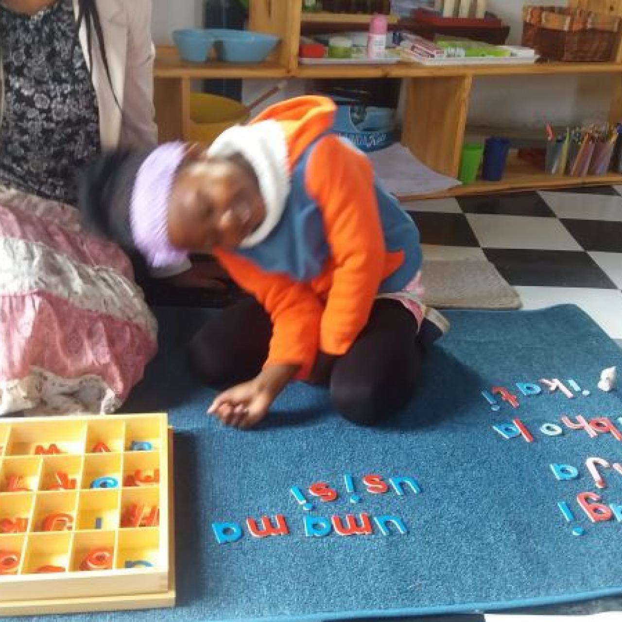 Aphumelele clocking the new isiXhosa Movable Alphabet